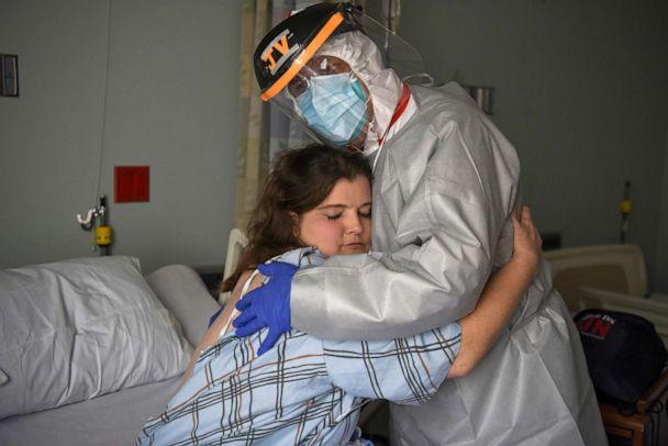 PHOTO: Dr. Joseph Varon hugs Christina Mathers, 43, a nurse from his team who became infected with COVID-19, at United Memorial Medical Center, during the coronavirus disease (COVID-19) outbreak, in Houston, Texas, July 25, 2020. (Callaghan O'hare/Reuters)