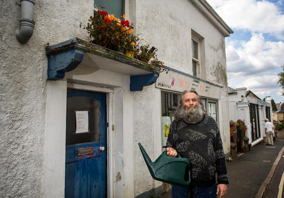 Peter Churcher, 66, claimed he was tendering to his hanging baskets in preparation for an in-bloom contest when