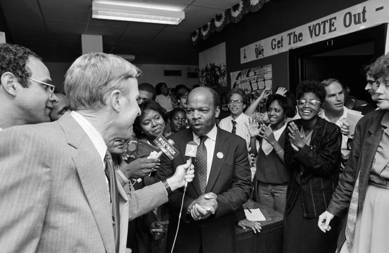 City Councilman John Lewis is surrounded by happy campaign supporters while he talks to the press after an unexpected victory over state Sen. Julian Bond in the Democratic runoff for the 5th Congressional District seat late on Sept. 2, 1986. Underdog Lewis trailed throughout the sometimes bitter primary against Bond, his longtime friend and civil rights ally. (Photo: Bettmann Archive/Getty Images)