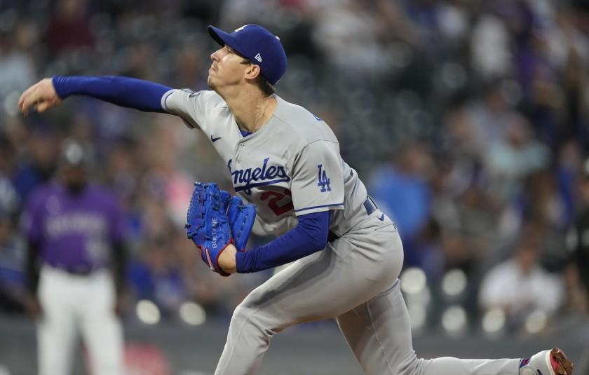 Los Angeles Dodgers starting pitcher Walker Buehler works against the Colorado Rockies in the first inning of a baseball game Wednesday, Sept. 22, 2021, in Denver. (AP Photo/David Zalubowski)