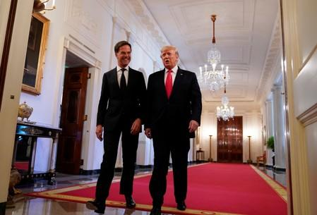 Trump and Netherlands' Prime Minister Rutte take part in a flag presentation at the White House in Washington