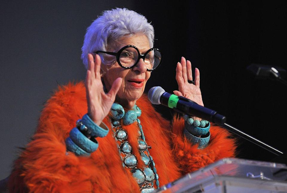 <p>One of her signature looks, Iris makes a bold statement wearing an orange faux fur coat with a carved turquoise bangles and a large turquoise necklace. She is the queen of pairing warm and cool colors.<br></p>