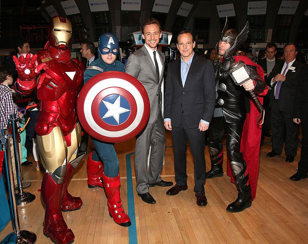 """Even Wall Street apparently has """"Avengers"""" fever. The film's stars Tom Hiddleston and Clark Gregg rang the opening bell at the New York Stock Exchange on Tuesday along with a few of the flick's superheroes. (5/1/2012)"""