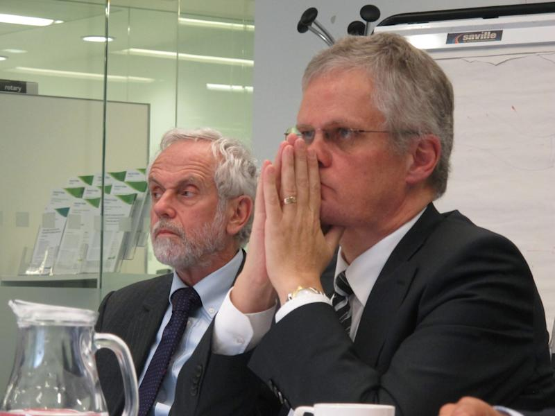 Halldor Thorgeirsson, right, a senior director with the United Nations Framework Convention on Climate Change, and researcher Brian Hoskins take questions during a press briefing at London's Imperial College on Tuesday, Sept. 17, 2013. Thorgeirsson said international leaders are failing to fight global warming, appealing directly to the world's voters to pressure their politicians into taking tougher action against the buildup of greenhouse gases. (AP Photo/Raphael Satter)