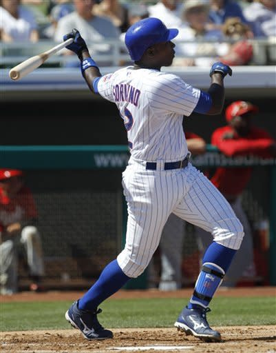 Chicago Cubs' Alfonso Soriano watches his two-run home run against the Cincinnati Reds during the first inning of a MLB spring training baseball game in Mesa, Ariz., Monday, March 12, 2012. (AP Photo/Chris Carlson)