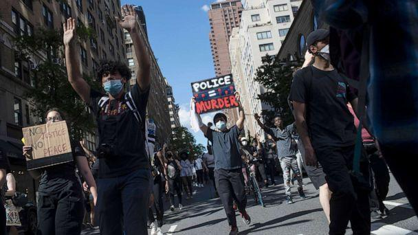 PHOTO: Protesters march during a solidarity rally for George Floyd, May 30, 2020, in New York. (Wong Maye-E/AP)