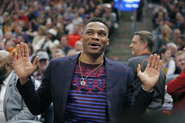 Houston Rockets guard Russell Westbrook reacts as he sits on the bench in the first half during an NBA basketball game against the Utah Jazz Monday, Jan. 27, 2020, in Salt Lake City. (AP Photo/Rick Bowmer)