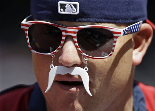 Cleveland Indians relief pitcher Vinnie Pestano wears red, white and blue novelty glasses during an interview before a baseball game against the Los Angeles Angels Wednesday, July 4, 2012, in Cleveland. (AP Photo/Mark Duncan)