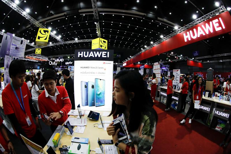 People visit the Huawei stand at the Mobile Expo in Bangkok, Thailand. (PHOTO: REUTERS/Jorge Silva)
