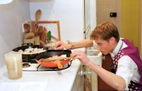 <p>Prince William channels his inner chef, making chicken paella as a student at Eton College. </p>