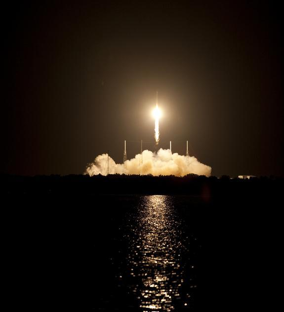 SpaceX's unmanned Dragon capsule rises into the Florida sky on the night of Oct. 7, 2012.