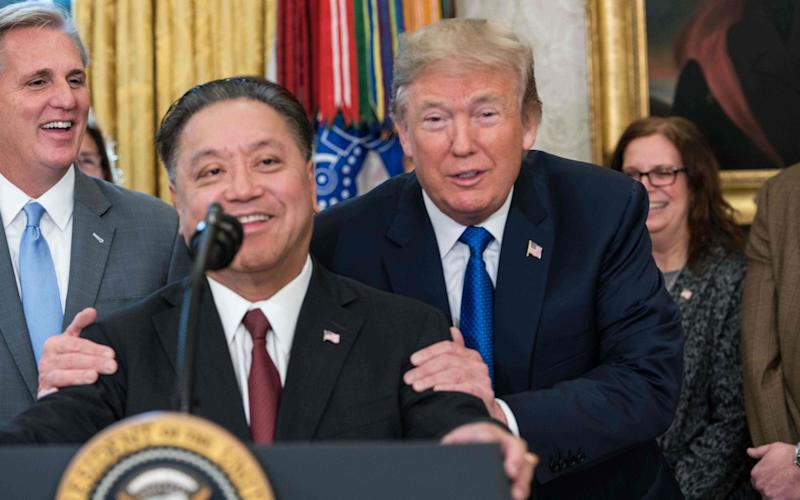 Broadcom chief executive Hock Tan with US President Donald Trump last year, before the bid for Qualcomm - AFP