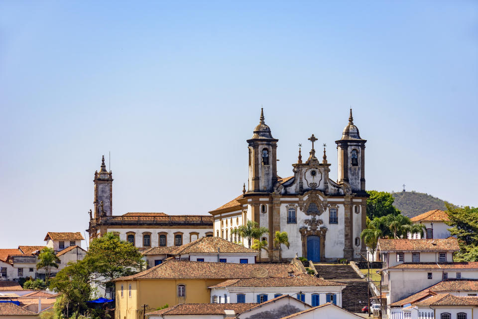 Bottom view of the historic center of Ouro Preto city with its houses, church, monuments and mountains