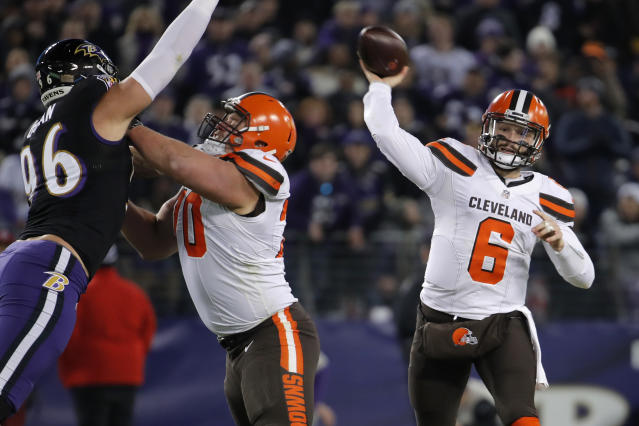 Cleveland Browns quarterback Baker Mayfield, right, throws a pass in the first half of an NFL football gameagainst the Baltimore Ravens, Sunday, Dec. 30, 2018, in Baltimore. (AP Photo/Carolyn Kaster)