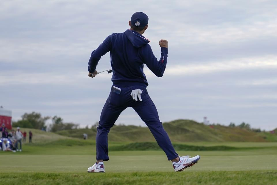 Team USA's Collin Morikawa makes a putt on the 15th hole during a four-ball match the Ryder Cup at the Whistling Straits Golf Course Saturday, Sept. 25, 2021, in Sheboygan, Wis. (AP Photo/Ashley Landis)