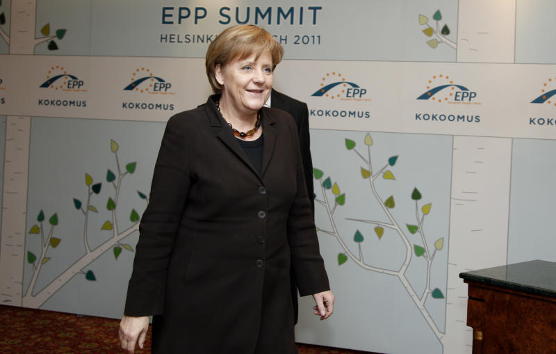 German Chancellor Angela Merkel arrives for the EPP party heads of state meeting at the Kamp Hotel in Helsinki, Friday, March 4, 2011. A series of EU summits this month kicks off Friday in Helsinki, where the eurozone's conservative leaders will wrestle over how much of their sovereign economic decision-making they are willing to sacrifice for the sake of a more stable euro. (AP Photo/Virginia Mayo)