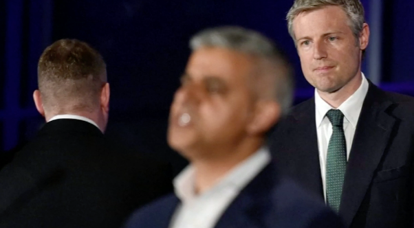 Britain First leader Paul Golding turns his back on Sadiq Khan during the mayor's victory speech while defeated Conservative candidate Zac Goldsmith watches on.