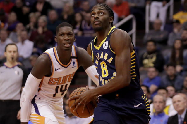 Indiana Pacers forward Justin Holiday (8) drives past Phoenix Suns forward Cheick Diallo (14) during the first half of an NBA basketball game, Wednesday, Jan. 22, 2020, in Phoenix. (AP Photo/Matt York)