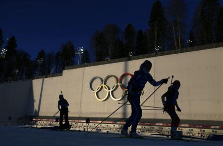 """Olympic skiers take part in a biathlon training session for the 2014 Sochi Winter Olympic Games at the """"Laura"""" cross-country and biathlon centre in Rosa Khutor"""