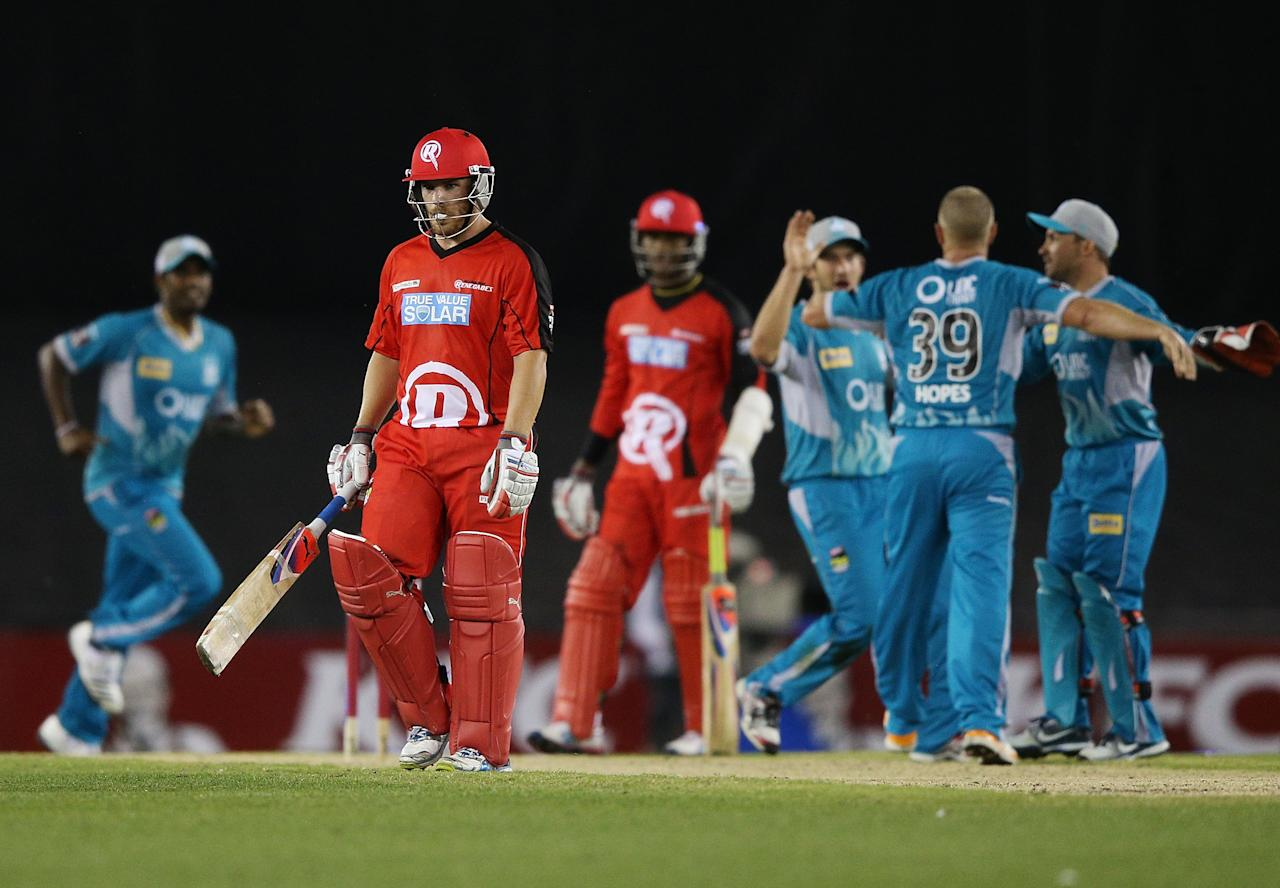 MELBOURNE, AUSTRALIA - DECEMBER 22:  Heat players celebrate the wicket of Aaron Finch of the Renegades during the Big Bash League match between the Melborune Renegades and the Brisbane Heat at Etihad Stadium on December 22, 2012 in Melbourne, Australia.  (Photo by Michael Dodge/Getty Images)