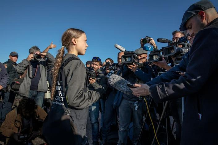 Greta Thunberg addresses supporters and journalists upon her arrival in Santo Amaro Recreation dock on December 03, 2019 in Lisbon, Portugal. | Evgenia Arbugaeva for TIME