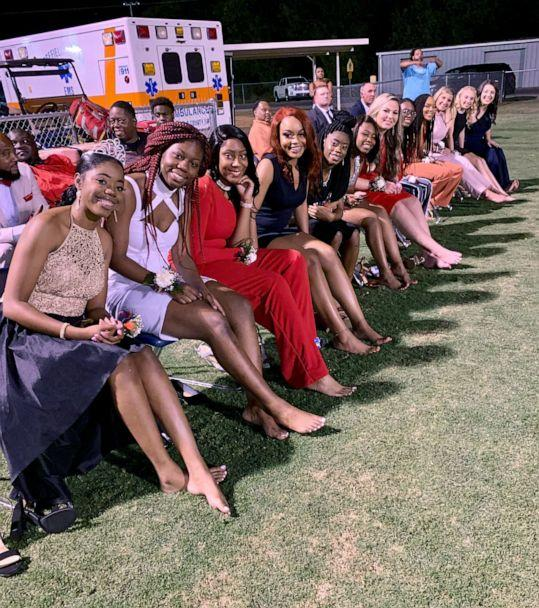 PHOTO: Twelve homecoming court candidates who walked barefoot across a football field in South Carolina in solidarity with their classmate. (Crystal Lotz Hadden)