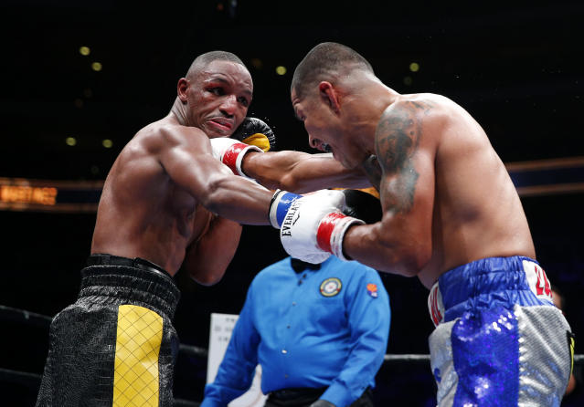 Devon Alexander (left) exchanges punches with Aaron Martinez during their 2015 bout. (Reuters)