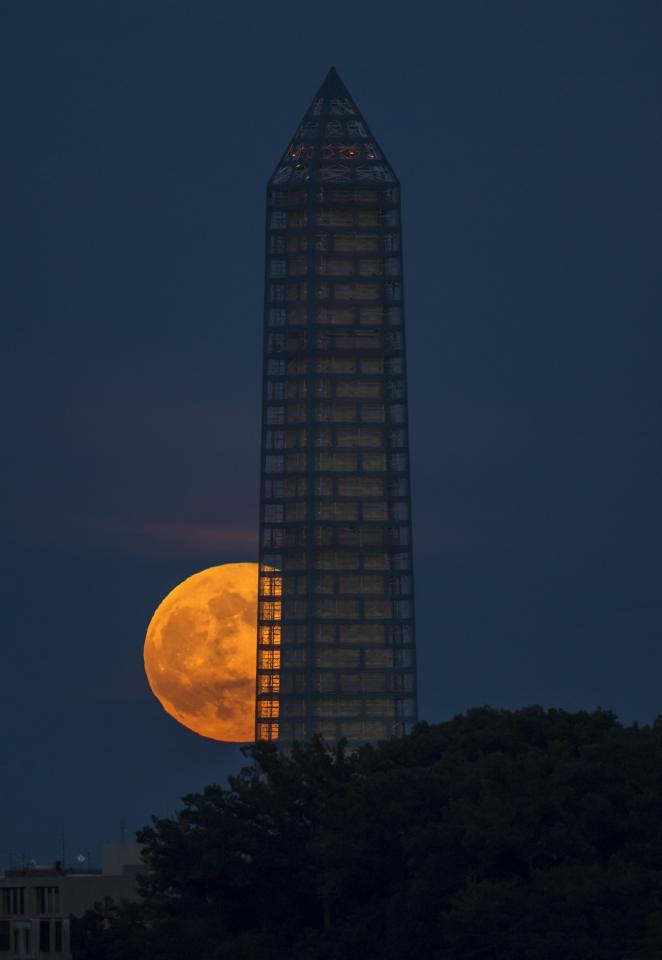 WASHINGTON, DC - JUNE 23: In this handout image provided by NASA, a supermoon rises behind the Washington Monument on June 23, 2013 in Washington, DC. This year the supermoon is up to 13.5% larger and 30% brighter than a typical full moon. (Photo by Bill Ingalls/NASA via Getty Images)