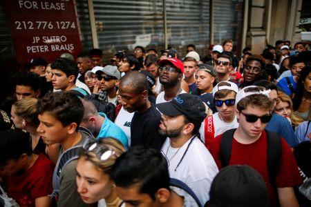 Shoppers line up around the block to visit a pop up store featuring fashion by Kanye West in Manhattan, New York