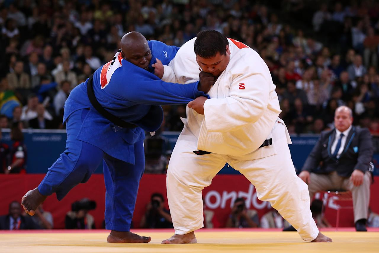 LONDON, ENGLAND - AUGUST 03:  Ricardo Blas Jr of the United States competes with Facinet Keita of Guinea in the Men's  100 kg Judo on Day 7 of the London 2012 Olympic Games at ExCeL on August 3, 2012 in London, England.  (Photo by Quinn Rooney/Getty Images)