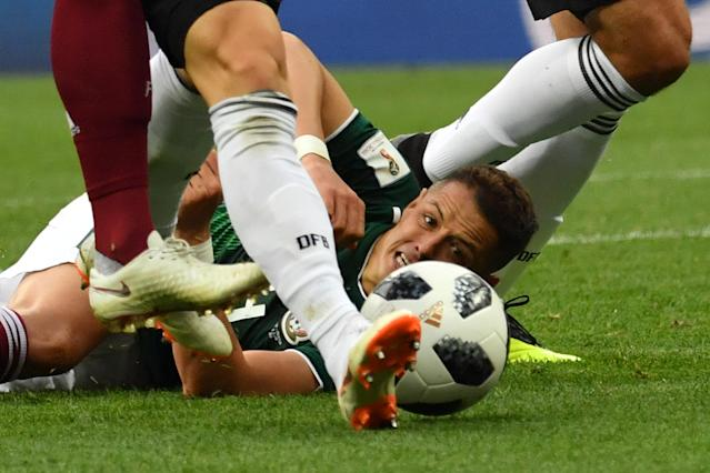 <p>Mexico's forward Javier Hernandez lies on the pitch during the Russia 2018 World Cup Group F football match between Germany and Mexico at the Luzhniki Stadium in Moscow on June 17, 2018. (Photo by Yuri CORTEZ / AFP) </p>