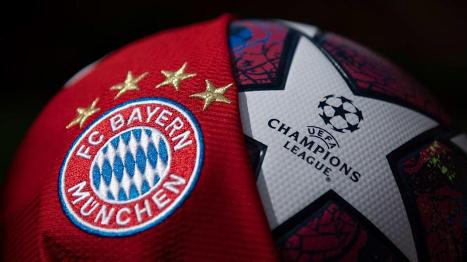 The FC Bayern Munich Club Badge and UEFA Champions League Match Ball | Visionhaus/Getty Images