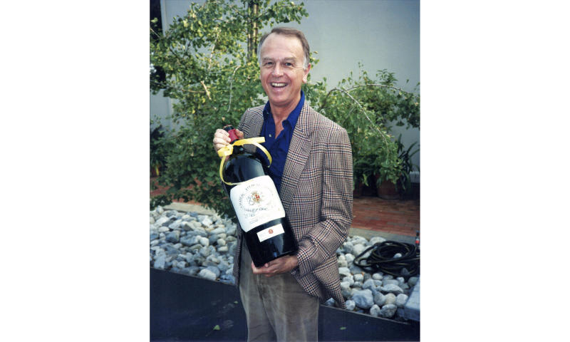 This circa 1985 photo provided by Esme Gibson shows Joe Coulombe, the founder of the Trader Joe's market chain, at his home in Pasadena, Calif. Coulombe, the man who created Trader Joe's markets with a vision that college-educated but poorly paid young people would buy healthy foods if they could only afford them, has died. Coulombe's family says he died Friday, Feb. 28, 2020 at age 89. He opened the first of his quirky, nautically themed markets in Pasadena, California, in 1967. He stocked it with granola, organic foods and other items he bought directly from suppliers to hold prices down. Trader Joe's now has more than 500 stores in over 40 states. (Image by Esme via AP)
