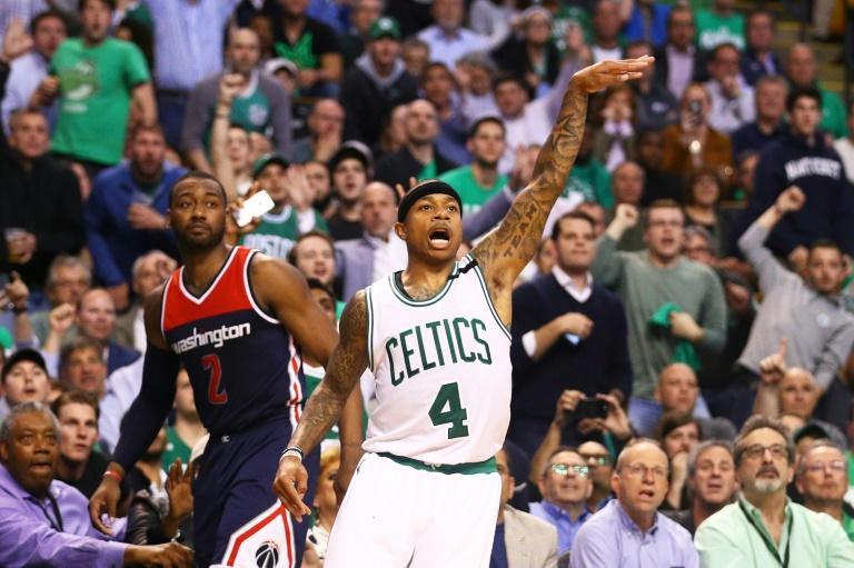 Isaiah Thomas of the Boston Celtics reacts after hitting a three point shot against the Washington Wizards during Game Two of the Eastern Conference Semifinals