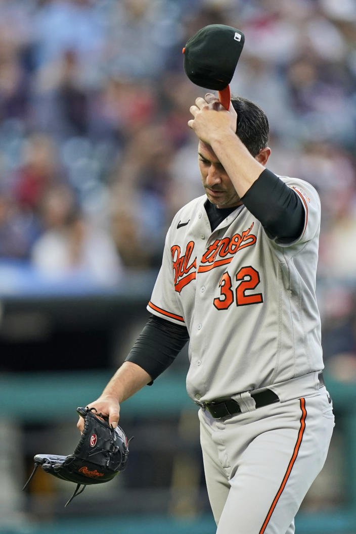 Baltimore Orioles starting pitcher Matt Harvey walks to the dugout in the fourth inning of a baseball game against the Cleveland Indians, Tuesday, June 15, 2021, in Cleveland. Harvey pitched 3 1/3 innings and gave up six hits and six runs. (AP Photo/Tony Dejak)