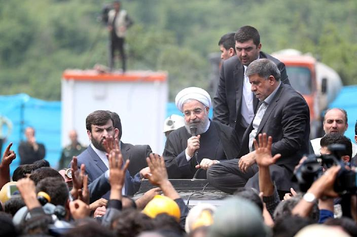 A handout picture provided by the office of Iranian President Hassan Rouhani on May 7, 2017 shows him visiting coal miners and rescue workers at the scene of an explosion in Azadshahr, in northern Iran (AFP Photo/HO)
