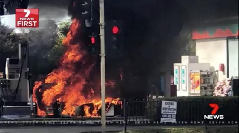 Moments later, the car and bowser were engulfed in flames. Source: 7 News