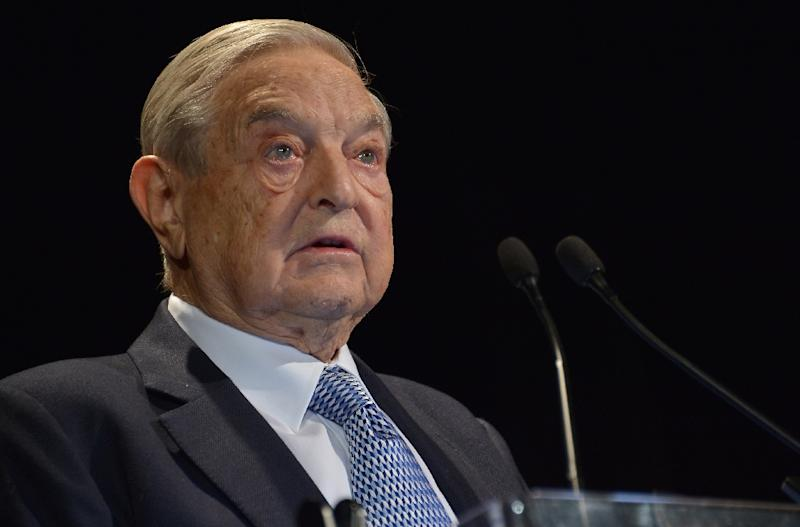 US financier George Soros speaks onstage at the Annual Freedom Award Benefit hosted by the International Rescue Committee at the Waldorf-Astoria hotel in New York City on November 6, 2013