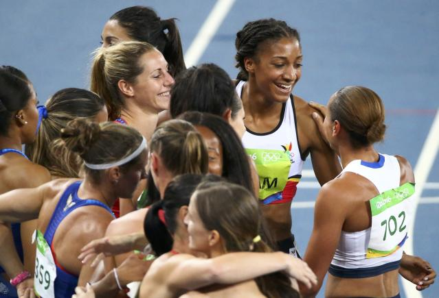 2016 Rio Olympics - Athletics - Final - Women's Heptathlon 800m - Olympic Stadium - Rio de Janeiro, Brazil - 13/08/2016. Jessica Ennis-Hill (GBR) of Britain congratulates Nafissatou Thiam (BEL) of Belgium. REUTERS/David Gray FOR EDITORIAL USE ONLY. NOT FOR SALE FOR MARKETING OR ADVERTISING CAMPAIGNS.