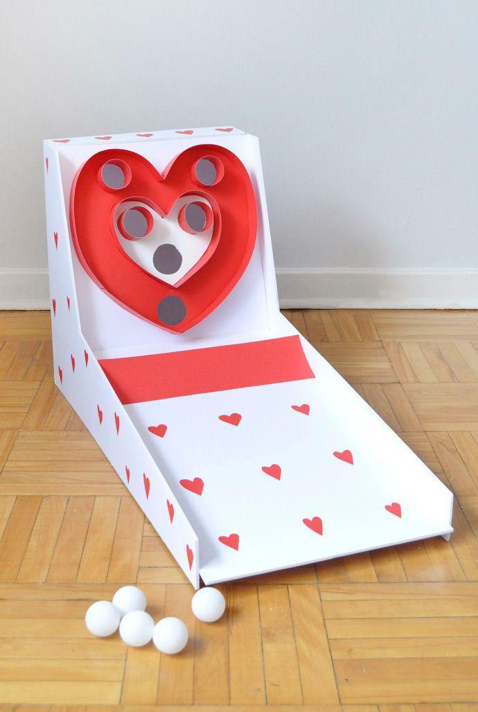 """<p>You can recreate your kid's favorite arcade game at home (with a special Valentine's Day twist) — just build the main structure using a foam core, then have your kids help you decorate with lots of hearts before trying to score points with ping pong balls.</p><p><em><a href=""""https://www.handmadecharlotte.com/valentines-day-carnival-diy-skeeball/"""" rel=""""nofollow noopener"""" target=""""_blank"""" data-ylk=""""slk:Get the tutorial at Handmade Charlotte »"""" class=""""link rapid-noclick-resp"""">Get the tutorial at Handmade Charlotte »</a></em><br></p>"""