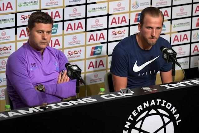 Mauricio Pochettino (L) said in Singapore that his team 'deserved to win' last month's Champions League final (AFP Photo/Roslan RAHMAN)