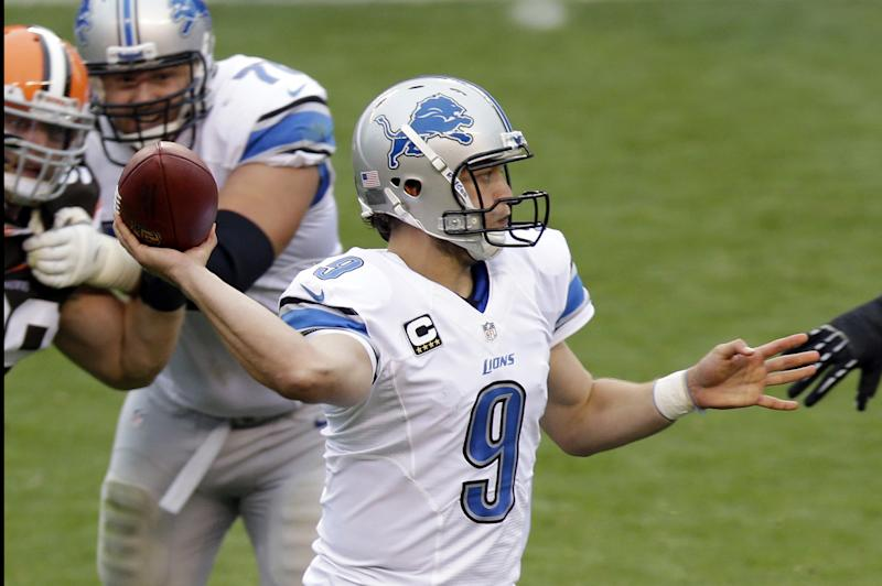 Detroit Lions quarterback Matthew Stafford passes against the Cleveland Browns in the third quarter of an NFL football game Sunday, Oct. 13, 2013, in Cleveland. Stafford threw for 248 yards and four touchdowns in a 31-17 win over Cleveland. (AP Photo/Tony Dejak)