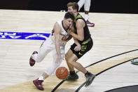 Virginia Tech's Hunter Cattoor, left, is fouled by South Florida's Mark Calleja in the second half of an NCAA college basketball game, Sunday, Nov. 29, 2020, in Uncasville, Conn. (AP Photo/Jessica Hill)