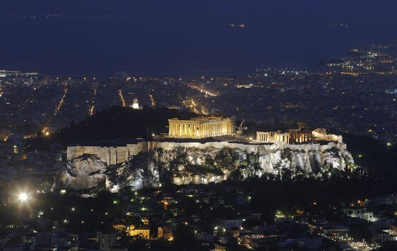 Athens and the temple of Parthenon, illuminated atop the Acropolis
