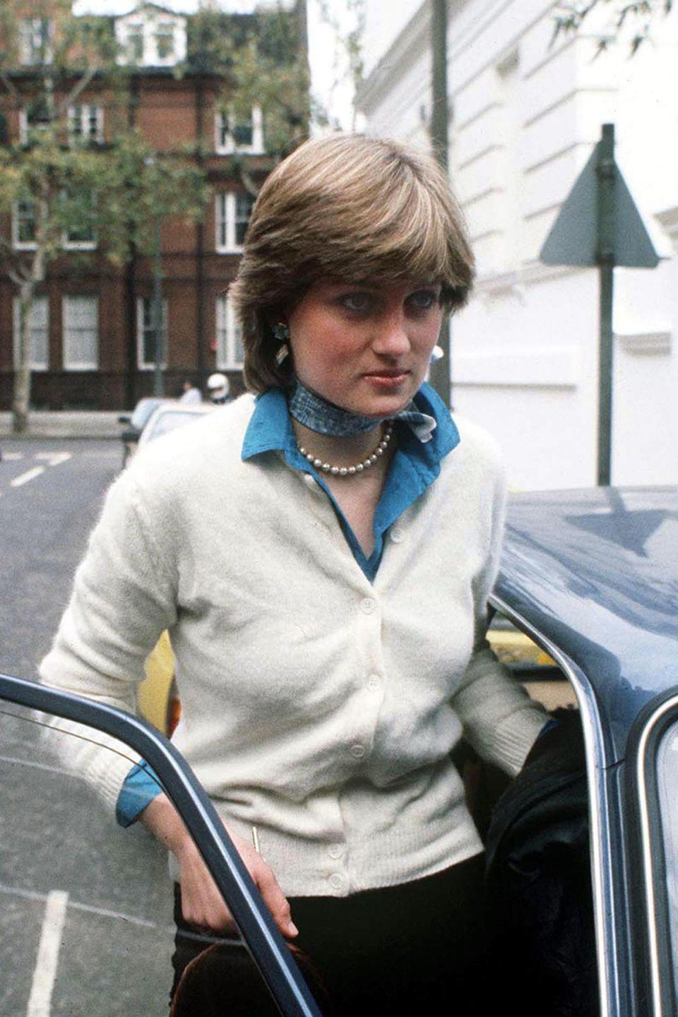 """<p>Photographed outside of her flat in December, Lady Diana Spencer was about to become the first Englishwoman in centuries to <a href=""""https://web.archive.org/web/20000819020342/http://www.washingtonpost.com/wp-srv/inatl/longterm/diana/stories/glamor0901.htm"""" rel=""""nofollow noopener"""" target=""""_blank"""" data-ylk=""""slk:marry an heir apparent"""" class=""""link rapid-noclick-resp"""">marry an heir apparent</a>, and the first one in all of royal history to have a paying job before the engagement.</p>"""