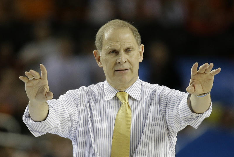 Michigan head coach John Beilein watches play against the Louisville during the second half of the NCAA Final Four tournament college basketball championship game Monday, April 8, 2013, in Atlanta. (AP Photo/David J. Phillip)