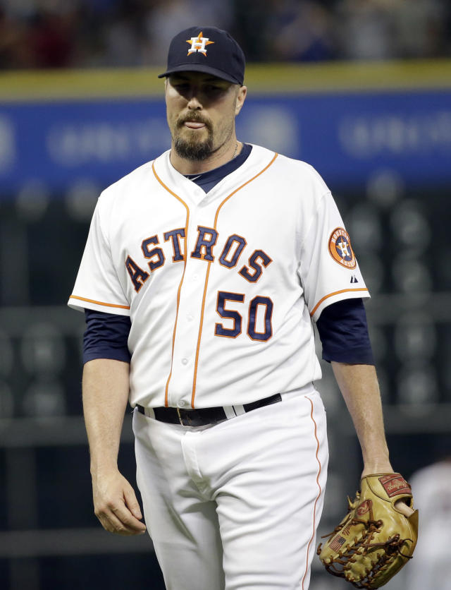 Houston Astros relief pitcher Chad Qualls reacts after giving up a home run to Toronto Blue Jays' Nolan Reimold during the ninth inning of a baseball game Thursday, July 31, 2014, in Houston. The Blue Jays won 6-5. (AP Photo/David J. Phillip)