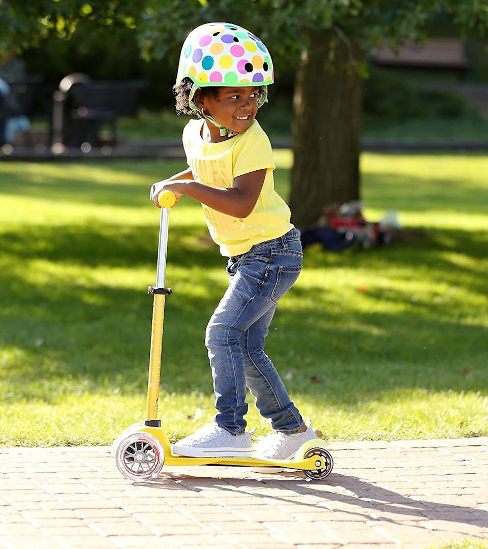 """It featuresan adjustable handlebar that'll grow with your toddler as they improve their balance and motor skills while whizzing by at seemingly breakneck speeds.Also includes a two-year manufacturer's warranty.<br /><br /><strong>Promising review:</strong>""""Best scooter ever! It's an easy assembly. It's a smooth ride and the perfect size for a 2-year-old. Spend more money and go with the deluxe model especially if your child is only 2. I brought this to the park today and two more of my mommy friends went home and bought their kids these today too! They come in the most beautiful colors.<strong>Kids are not really taught how to use these, they seem to just get on them and go!</strong>It was amazing to see my 2-year-old-take off like a champ!"""" --<a href=""""https://www.amazon.com/dp/B01BE0JEE2?tag=huffpost-bfsyndication-20&ascsubtag=5709944%2C15%2C32%2Cd%2C0%2C0%2C0%2C962%3A1%3B901%3A2%3B900%3A2%3B974%3A3%3B975%3A2%3B982%3A2%2C13752218%2C0"""" target=""""_blank"""" rel=""""noopener noreferrer"""">TexSpaceman12</a><br /><br /><strong>Get it from Amazon for <a href=""""https://www.amazon.com/dp/B01BE0JEE2?tag=huffpost-bfsyndication-20&ascsubtag=5709944%2C15%2C32%2Cd%2C0%2C0%2C0%2C962%3A1%3B901%3A2%3B900%3A2%3B974%3A3%3B975%3A2%3B982%3A2%2C13752218%2C0"""" target=""""_blank"""" rel=""""noopener noreferrer"""">$89.99</a> (available in 15 colors).</strong>"""