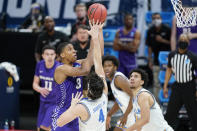 Abilene Christian's Joe Pleasant (32) shoots over UCLA's Jaime Jaquez Jr. (4) during the second half of a college basketball game in the second round of the NCAA tournament at Bankers Life Fieldhouse in Indianapolis Monday, March 22, 2021. (AP Photo/Mark Humphrey)