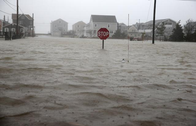 <p>Scituate Avenue in Scituate, Mass., is flooded during a nor'easter storm on March 2, 2018. (Photo: Jonathan Wiggs/The Boston Globe via Getty Images) </p>